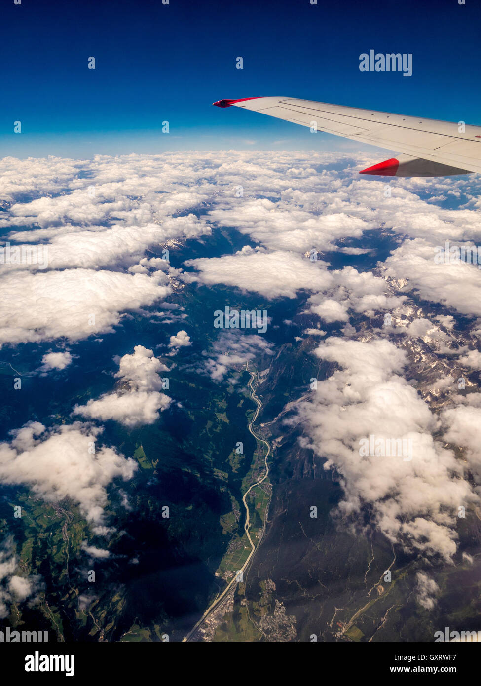 View through plane window over Alps - Stock Image