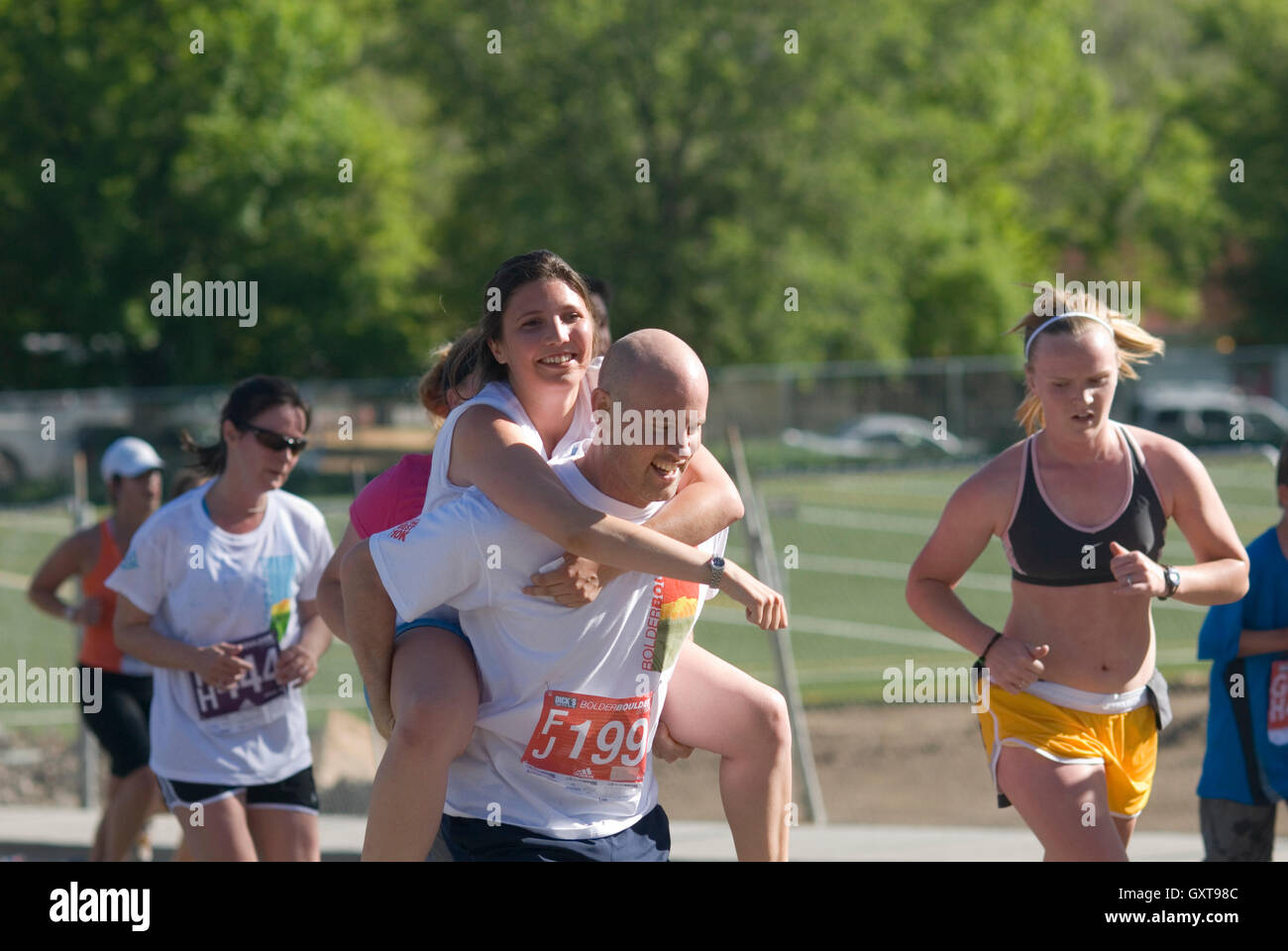 A little help from her friend during the Bolder Boulder! - Stock Image