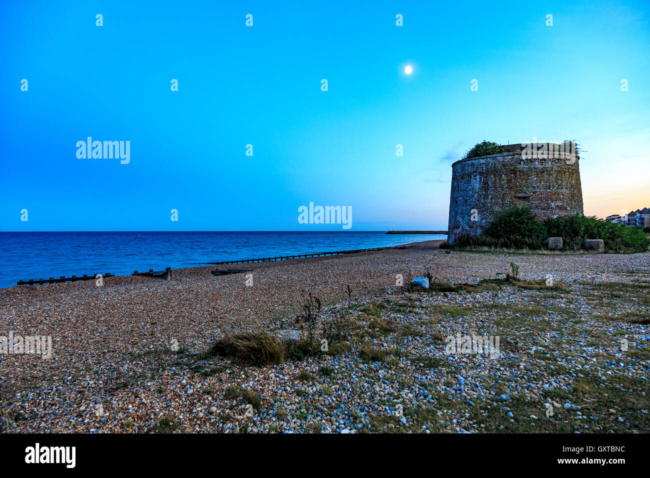 Dusk Martello Tower near The Sovereign Harbour  Eastbourne East Sussex - Stock Image
