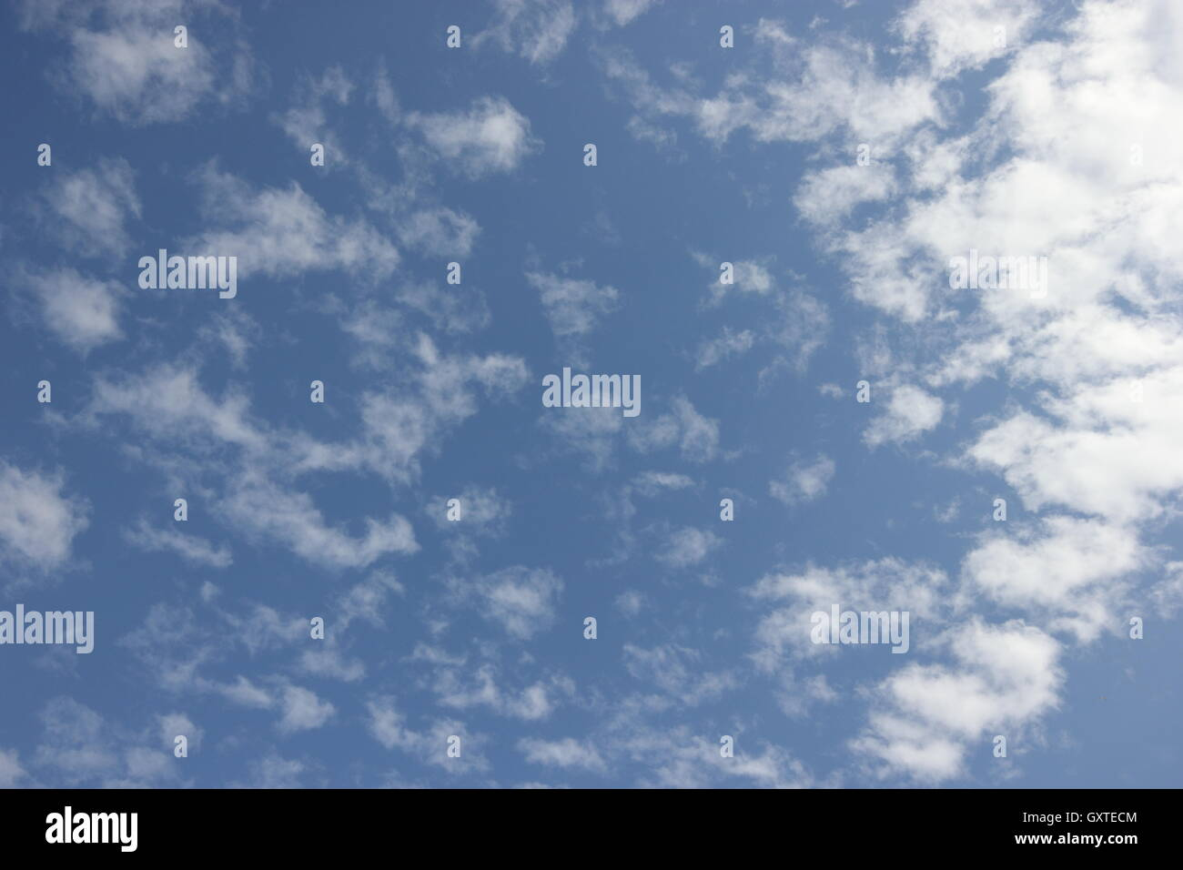 a beautifully blue cloudy sky - Stock Image