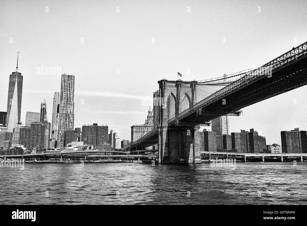 The Brooklyn Bridge, crossing over the East River into lower Manhattan Stock Photo