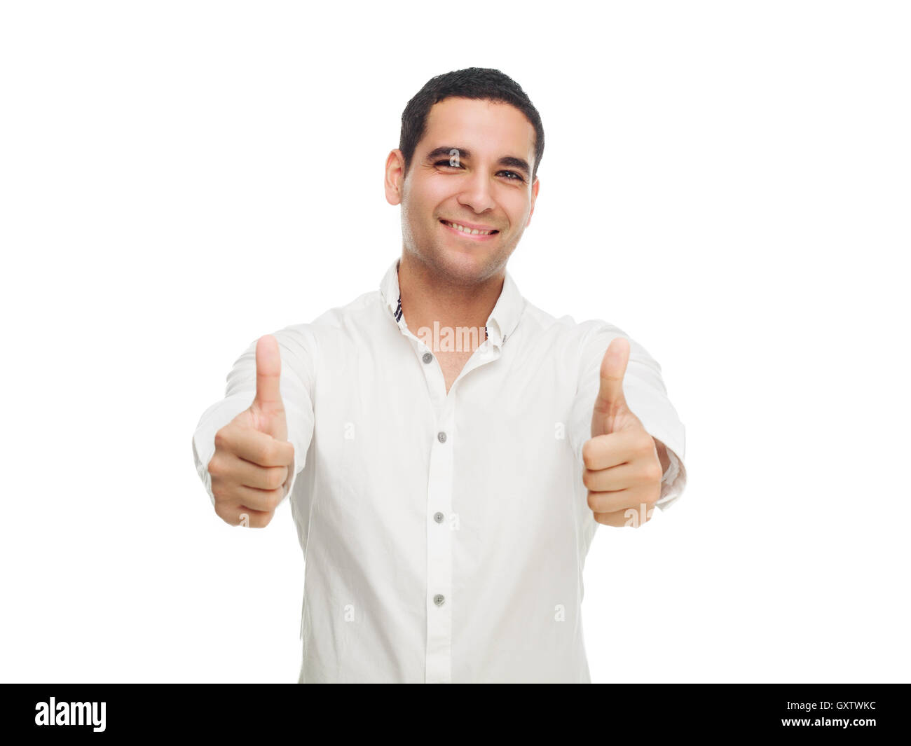 happy smiling young man with his thumbs up isolated against white studio background - Stock Image