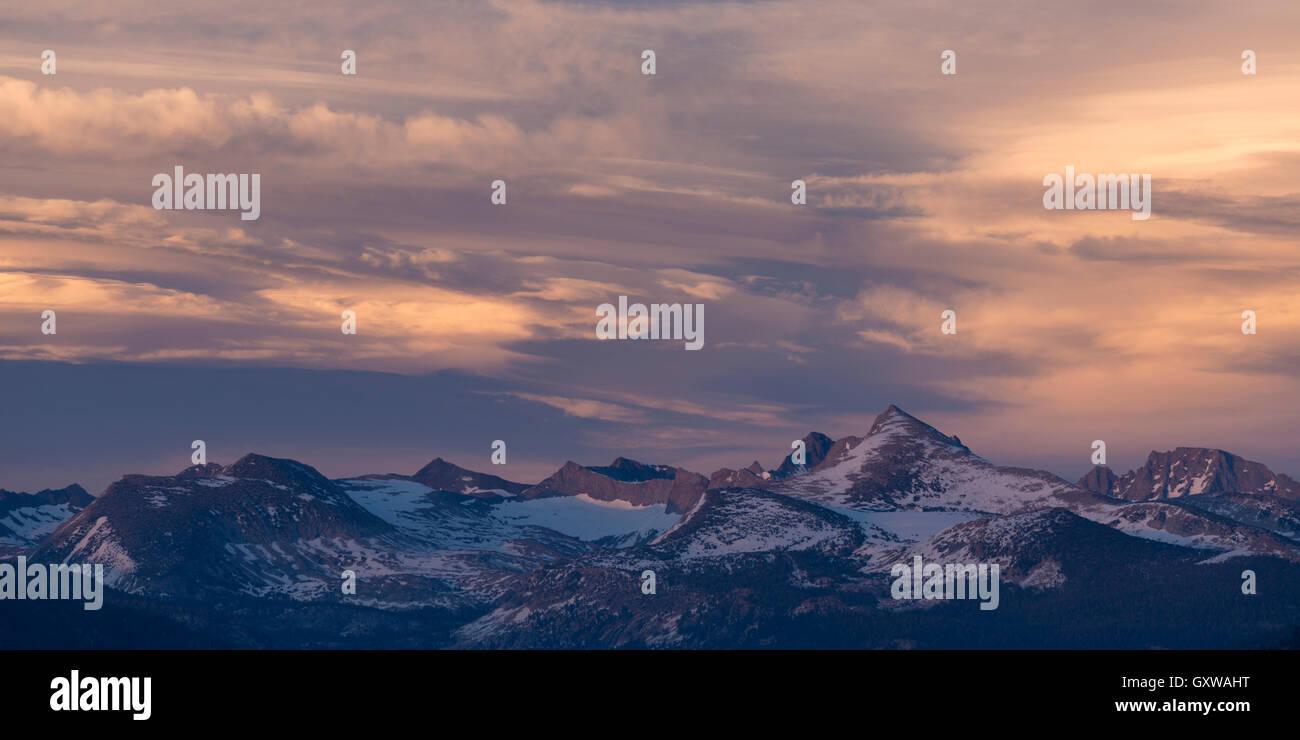 Sunset over Yosemite's highest mountains, including Mount Lyell, the highest peak in Yosemite National Park, California. Stock Photo