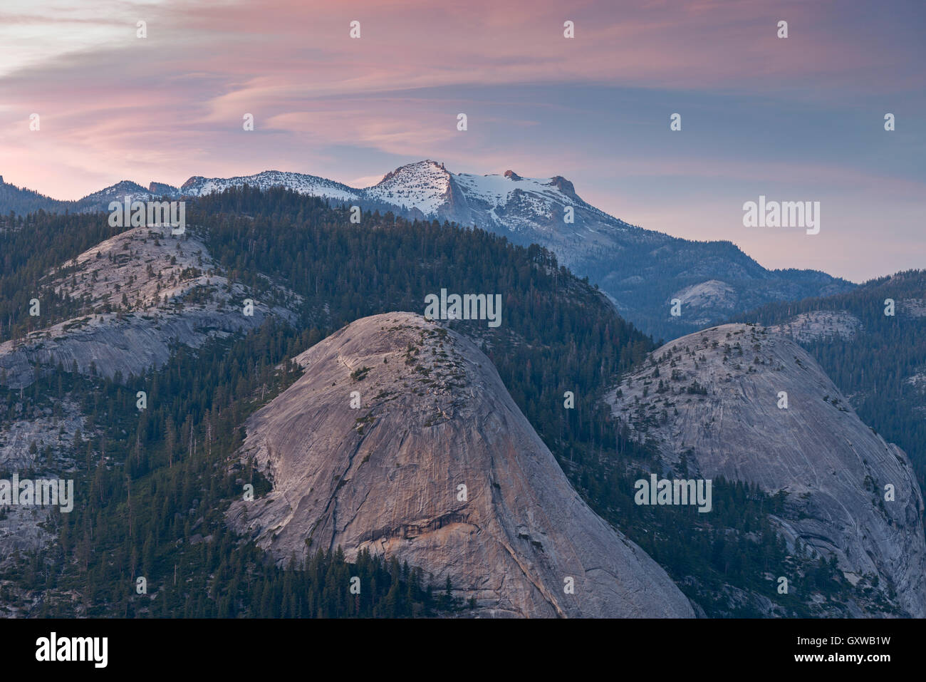 North Dome & Basket Dome with snow covered  Mount Hoffmann beyond, Yosemite National Park, California, USA. - Stock Image