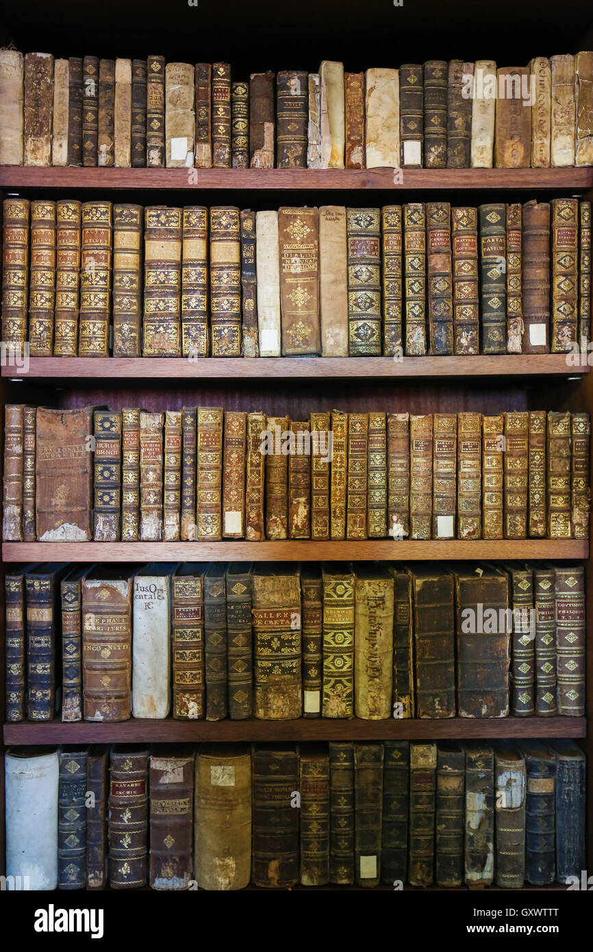 Old books in the Library of Coimbra, Portugal - Stock Image