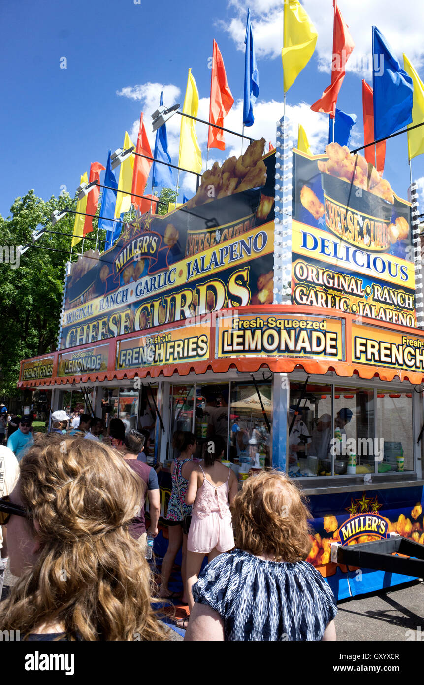 Garish food stand selling lemonade, French Fries and cheese curds at the Grand Old Day street fair. St Paul Minnesota - Stock Image