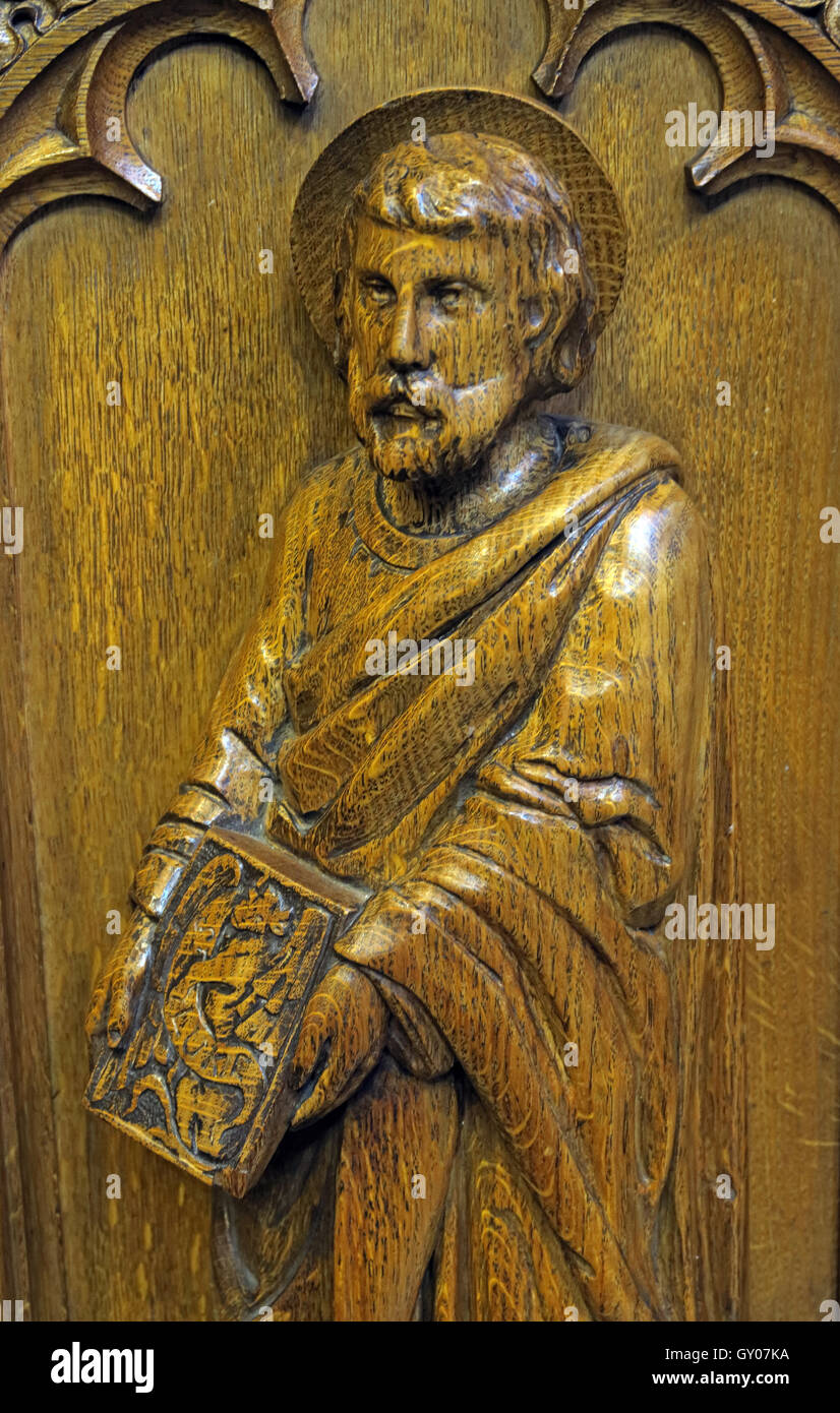 St Wilfrids Church Grappenhall- Pulpit wood carving of apostle, Warrington Stock Photo