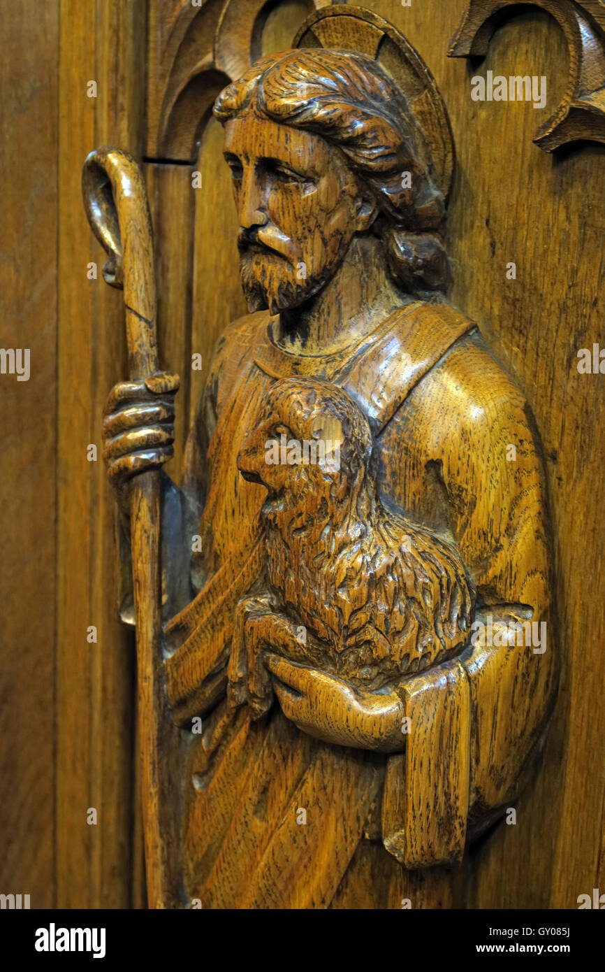 St Wilfrids Church Grappenhall- Pulpit wood carving of shepherd - Warrington - Stock Image