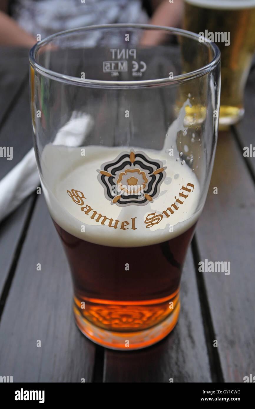 Glass Half Full,Samuel Smith pint glass, Vine Inn, Dunham, Altrincham,Cheshire,England,UK Stock Photo