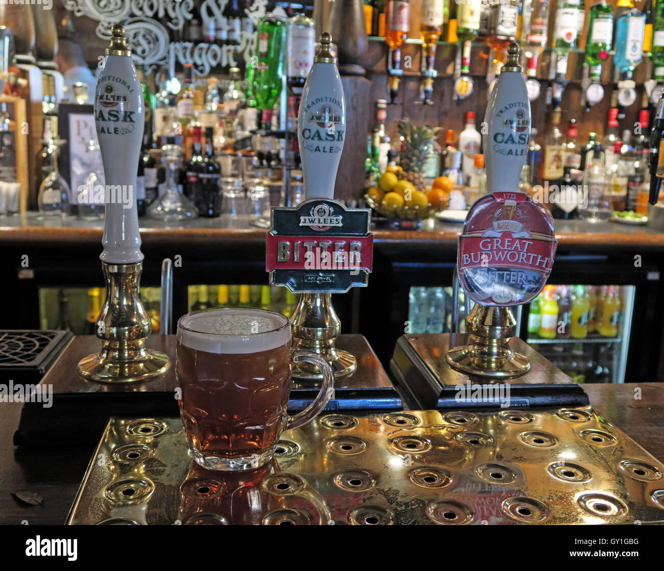 Traditional Pint of bitter on the bar, at the George & Dragon pub, Great Budworth Village, Cheshire, England - Stock Image