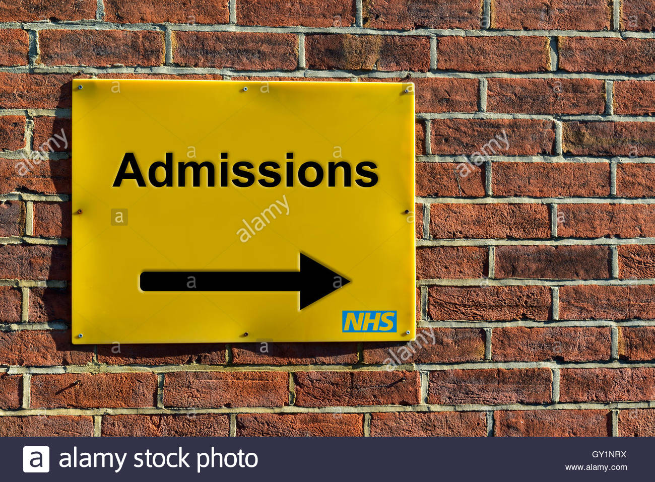Admissions, NHS wall mounted direction sign. - Stock Image