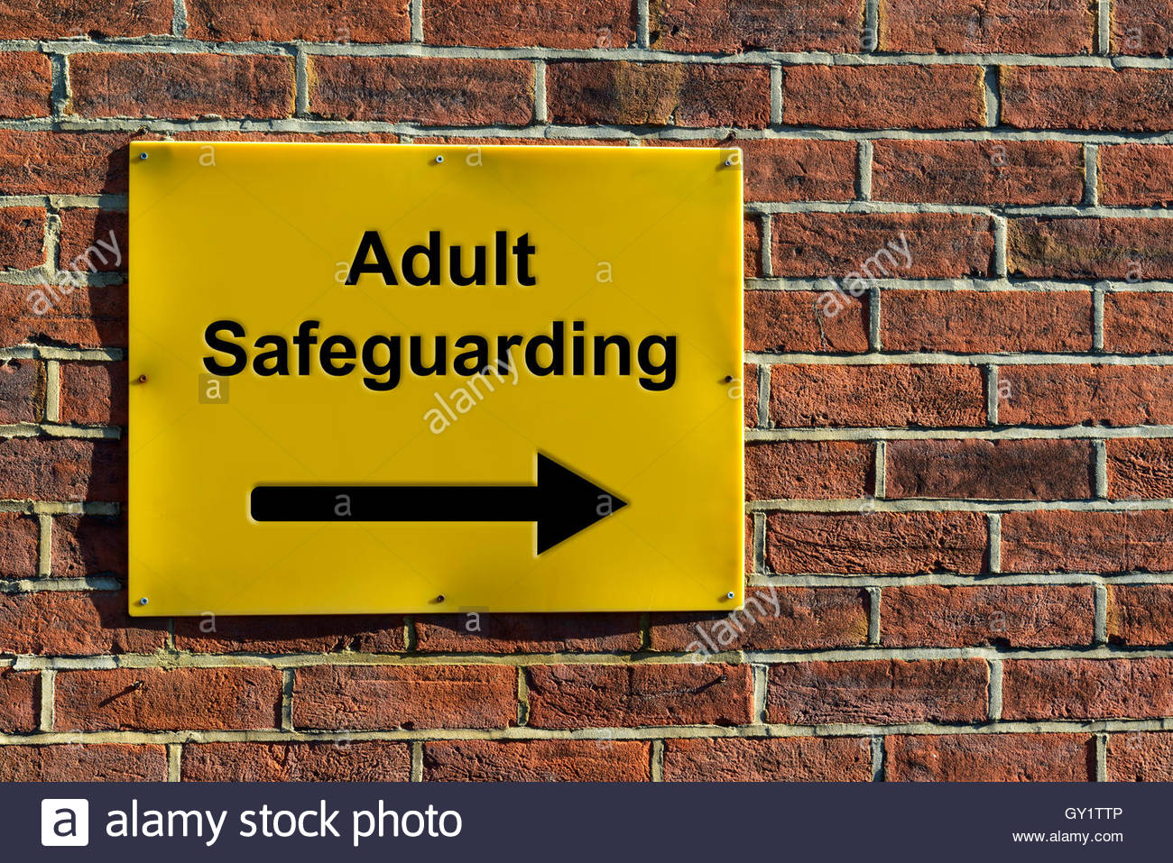 Adult Safeguarding, NHS wall mounted direction sign. - Stock Image