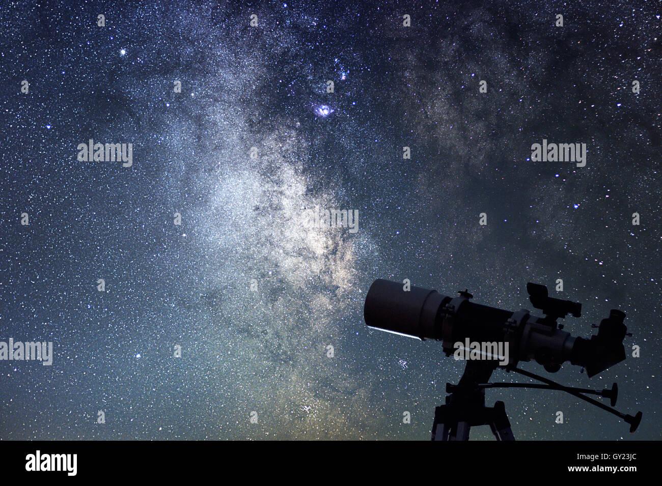 Telescope in starry night. Milky way and telescope. Astronomy - Stock Image