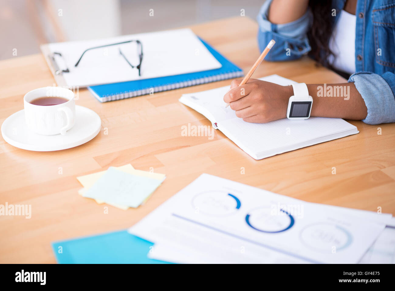 Pleasant woman making notes. - Stock Image