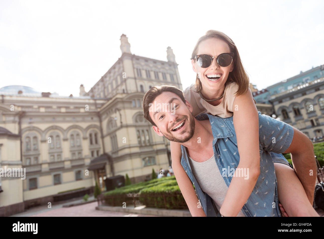 Attractive man and woman having rest - Stock Image