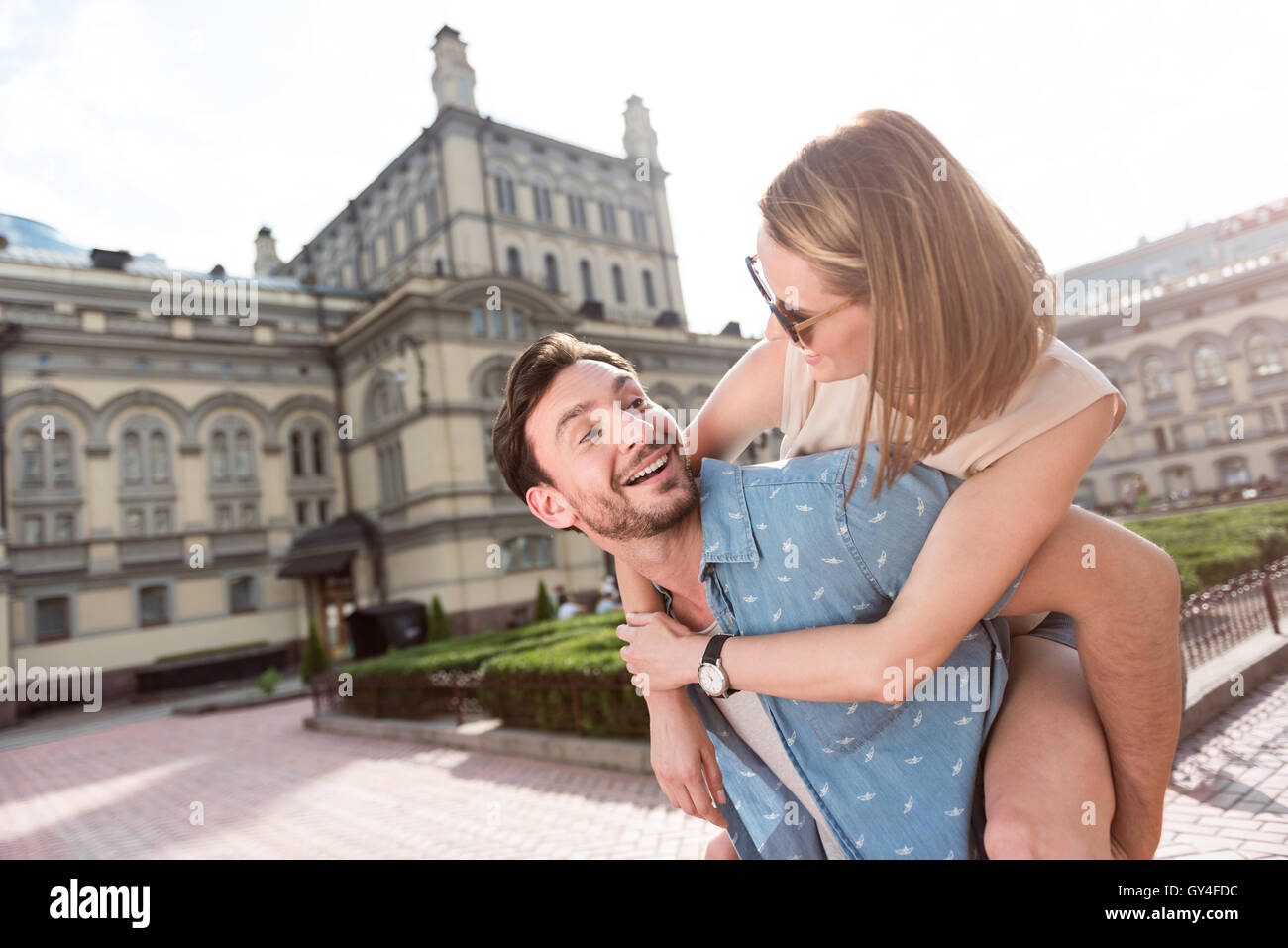 Lovely man and woman having rest - Stock Image