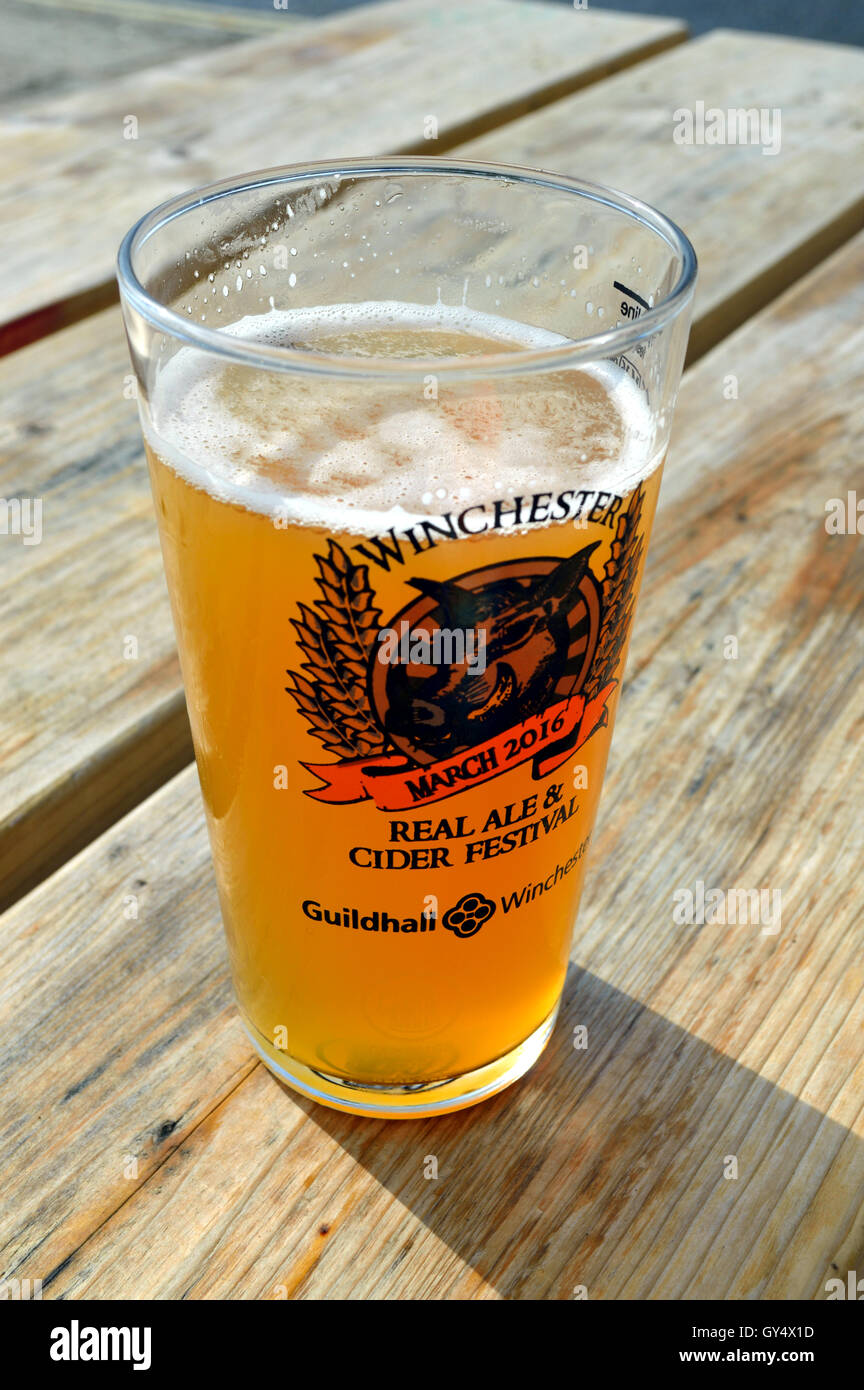 A pint of unfined India pale ale (IPA) in the sunshine. - Stock Image