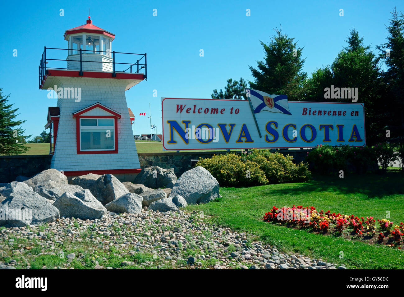 The Nova Scotia Canada border crossing at New Brunswick showing a lighthouse and welcoming sign at Amherst, N.S. - Stock Image