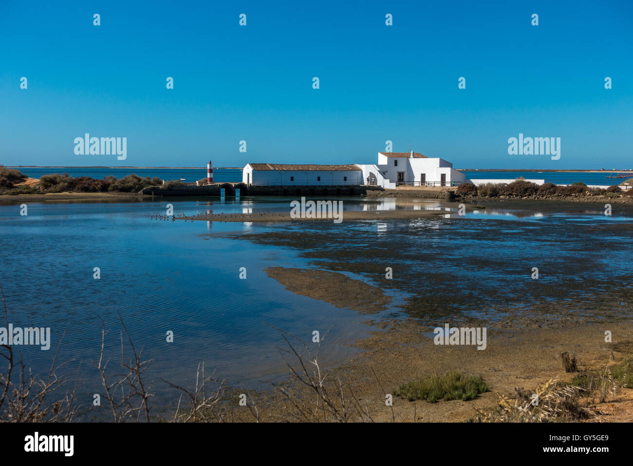 Old tidal mill (now a museum and wildlife haven), Ria Formosa Natural Park, Olhao, Algarve, Portugal - Stock Image
