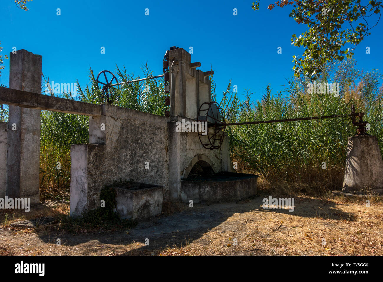 Old aqueduct for irrigation, Ria Formosa Natural Park, Olhao, Algarve, Portugal - Stock Image