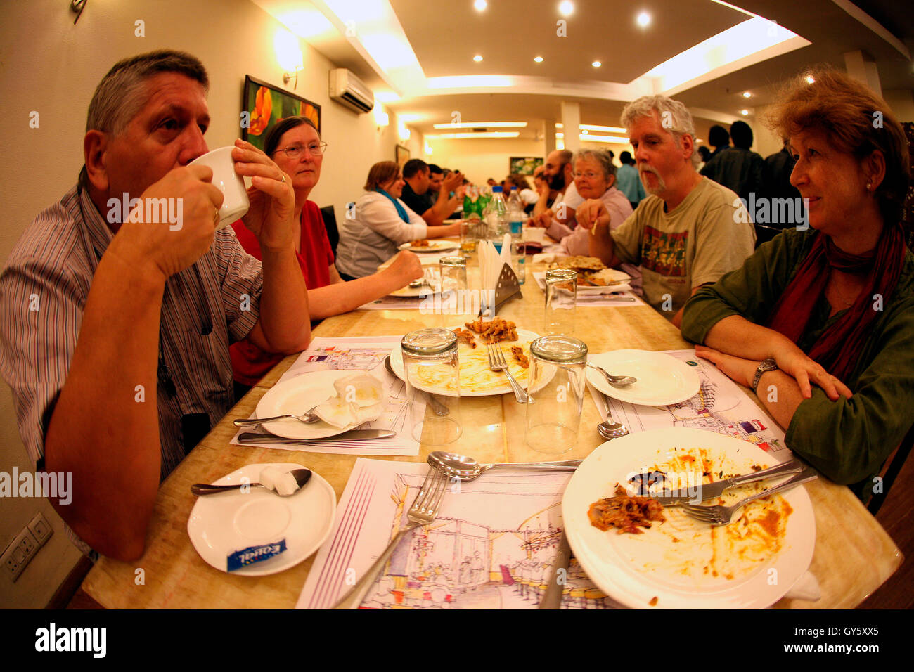 A farewell dinner meet (New Delhi, India) having members from different countries. - Stock Image