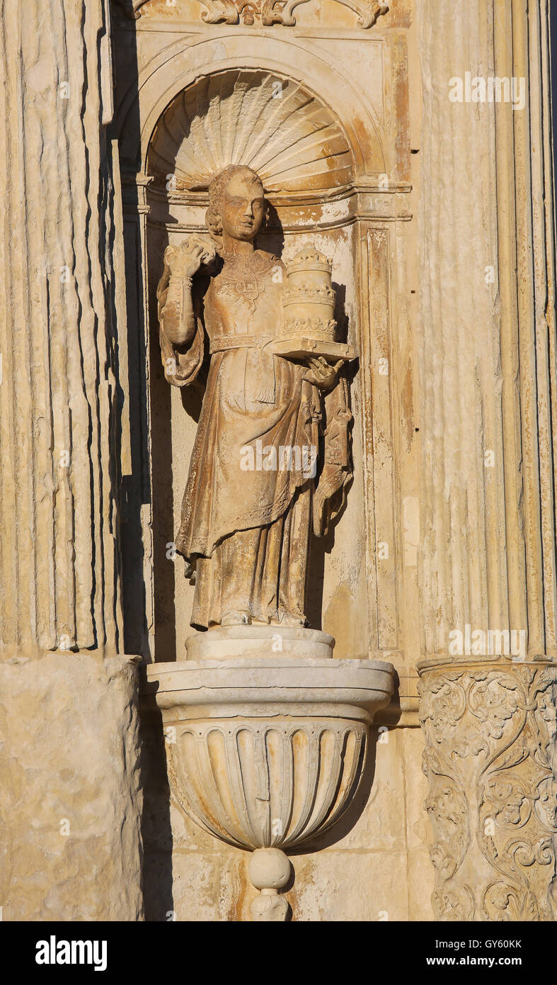 Statue representing Theology at the Palace Gate or Iron Gate in the University of Coimbra, Portugal - Stock Image