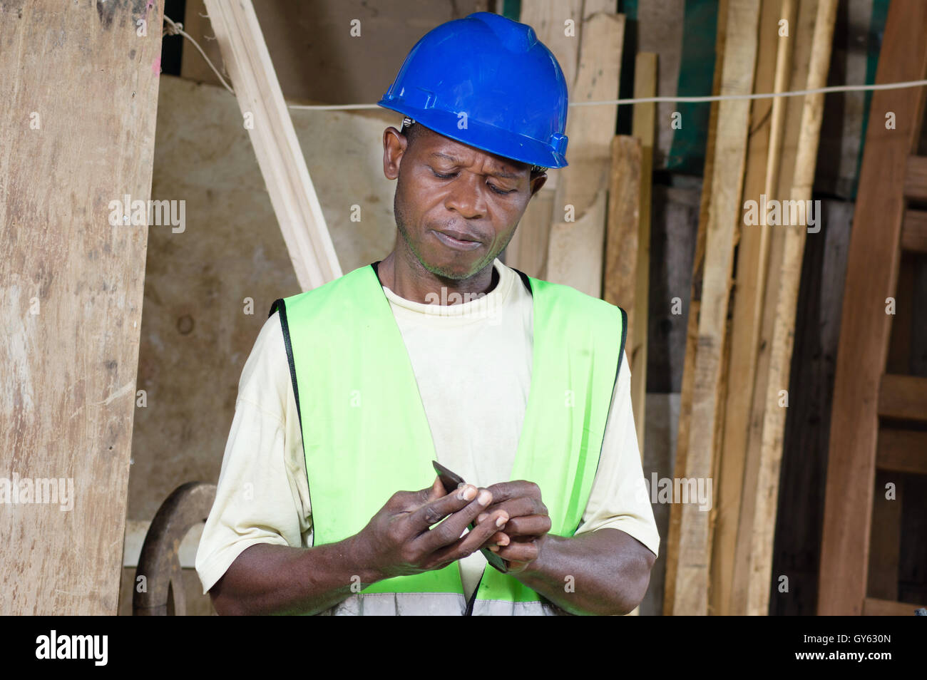 In the morning before starting work , the carpenter replace the blade of his plane. - Stock Image