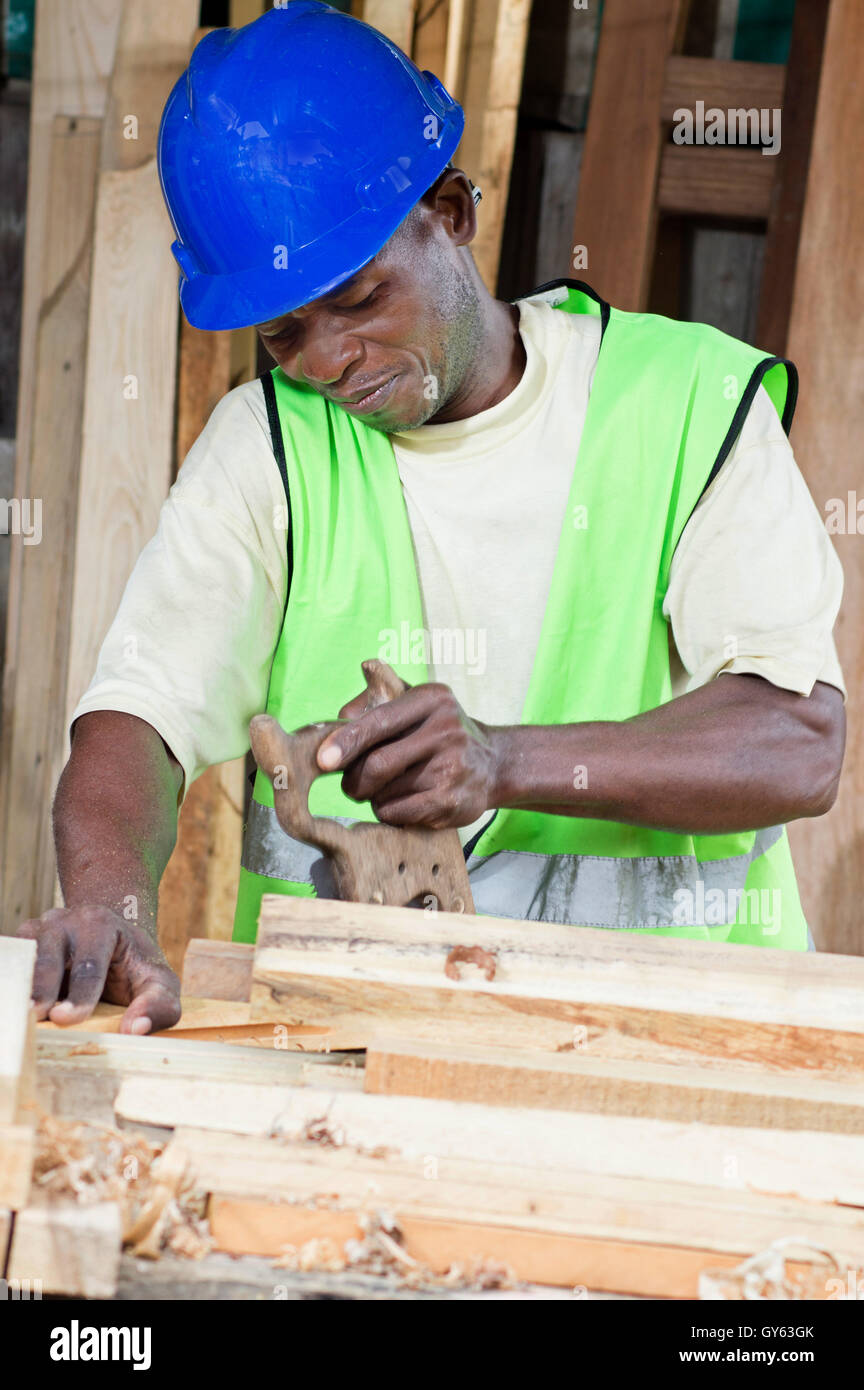 carpenter is being saved planks piled before him. - Stock Image