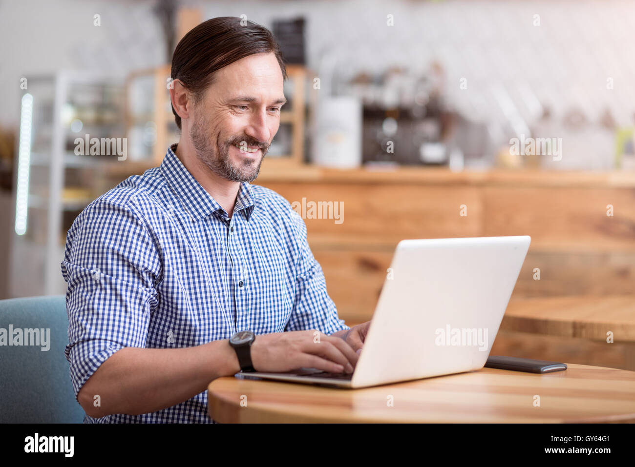 Handsome man using computer - Stock Image