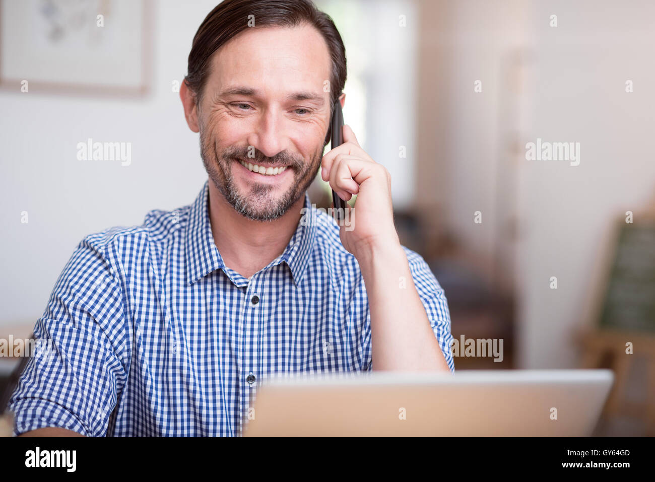 Handsome man using new technologies - Stock Image