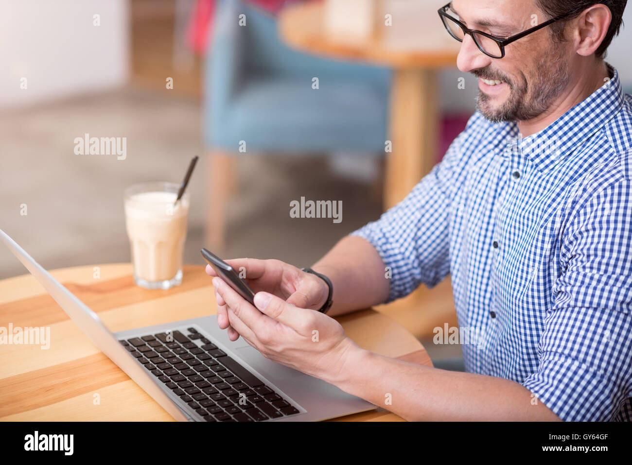 Handsome man using wearable technologies - Stock Image