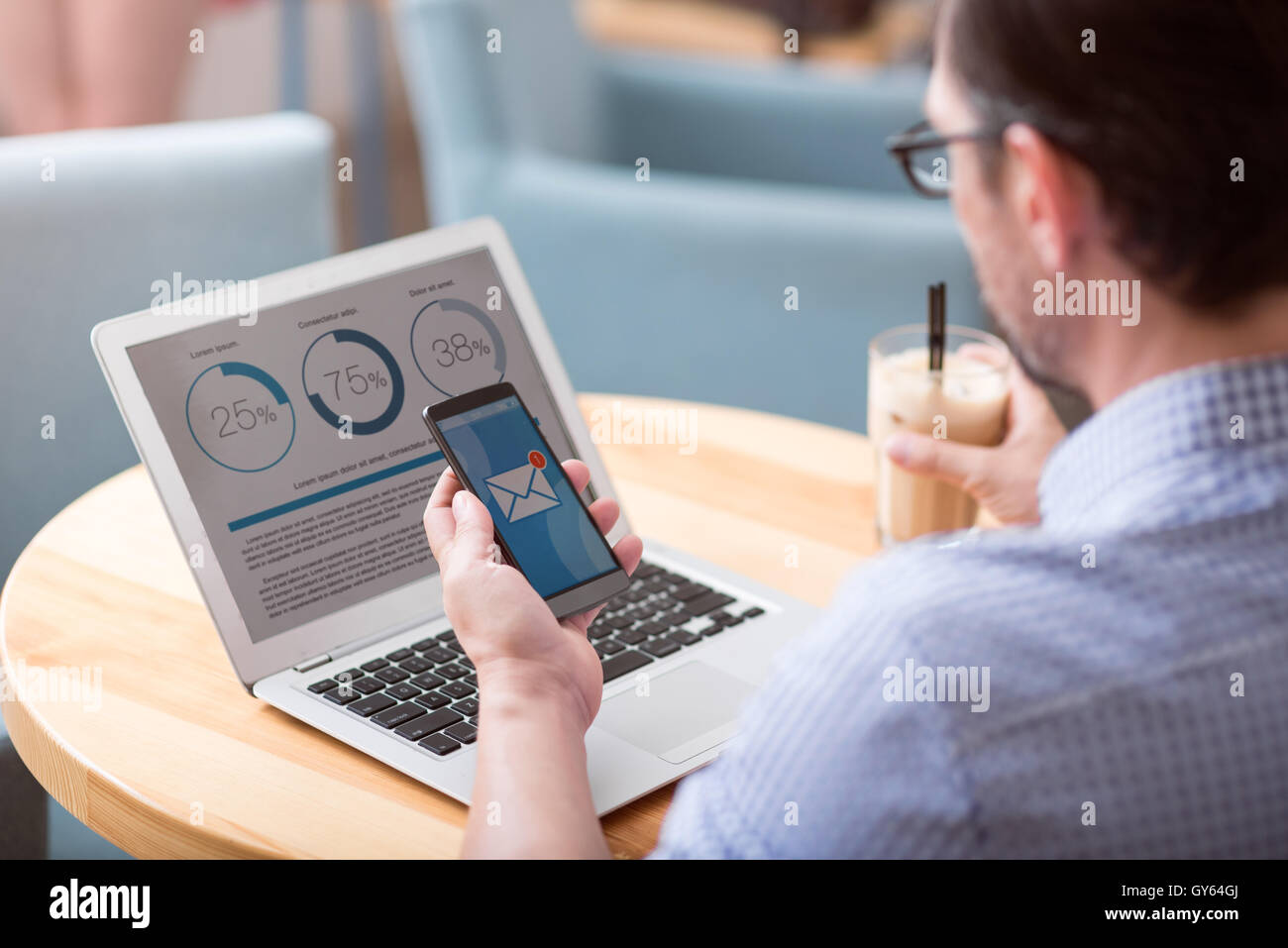 Handsome man working in the cafe - Stock Image