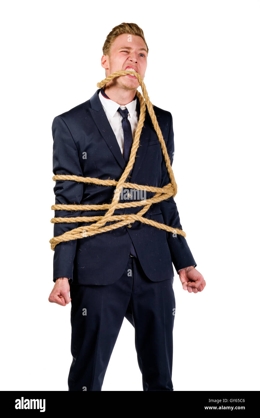 Young businessman in a suit tied up - Stock Image