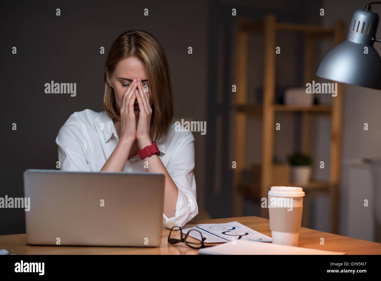 woman sitting at the table - Stock Image