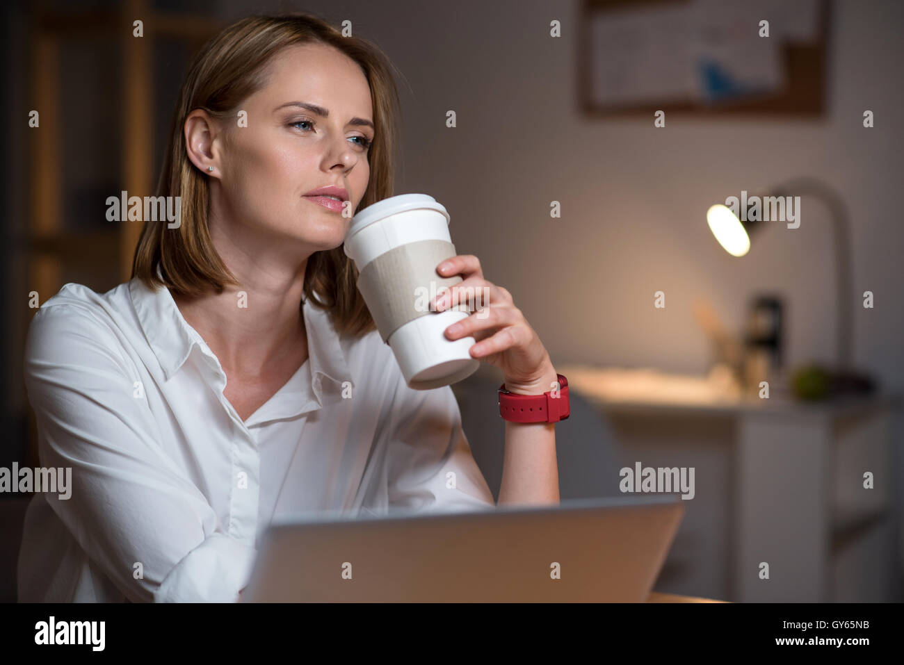 Pleasant thoughtful woman thinking - Stock Image