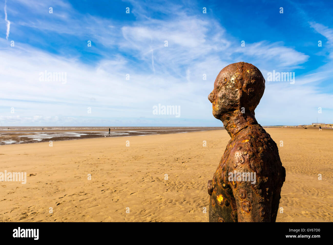 Crosby Beach near Liverpool with cast iron sculptures. - Stock Image