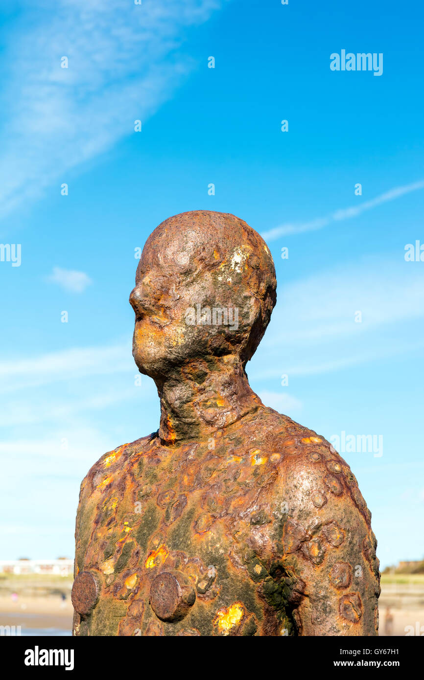 Detail of Another Place sculptures on Crosby Beach near Liverpool. - Stock Image