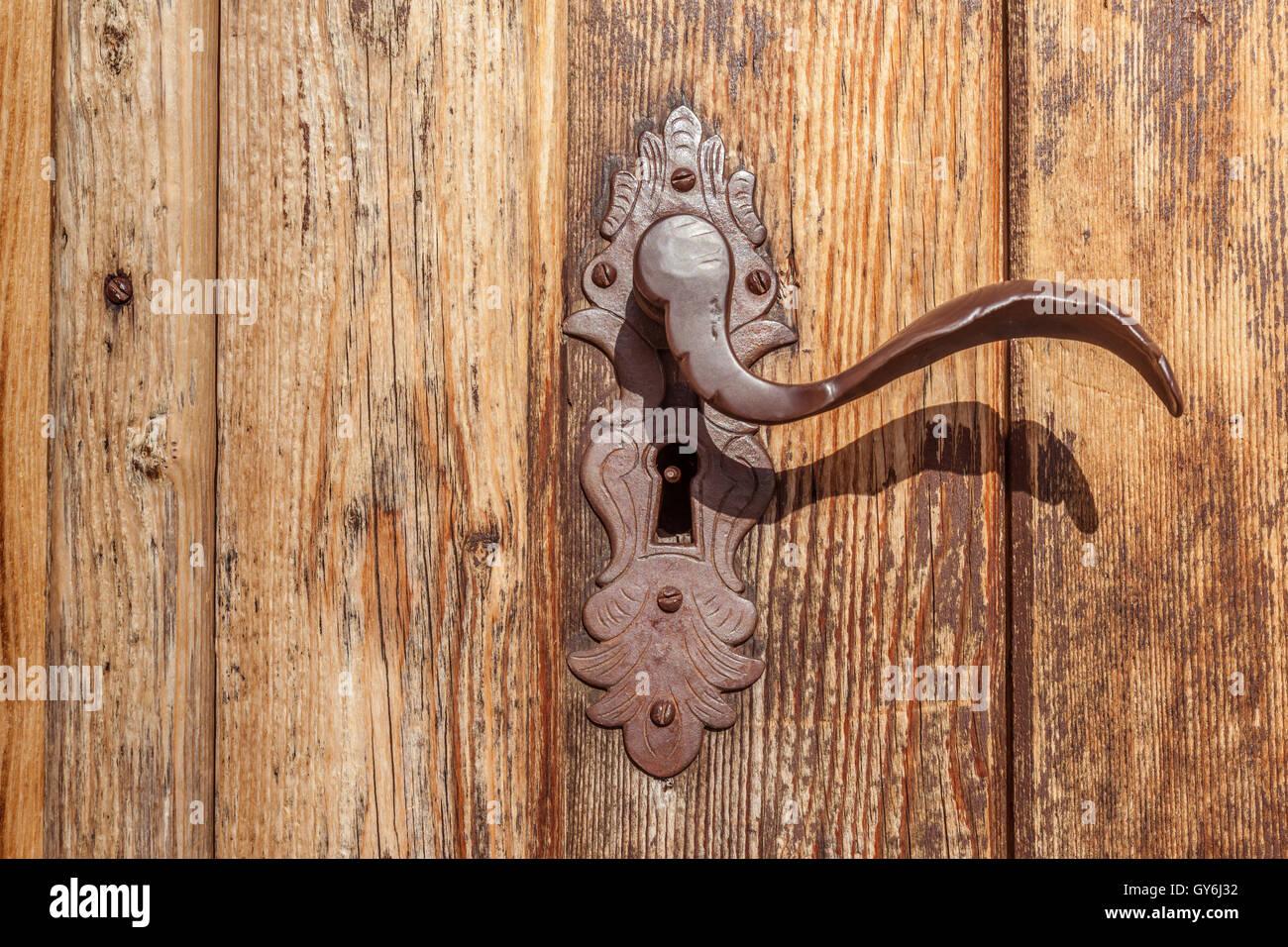 Door handle and old wooden door at the Holy Ghost Church in Kasern, Rear Ahrntal, South Tyrol, Italy - Stock Image