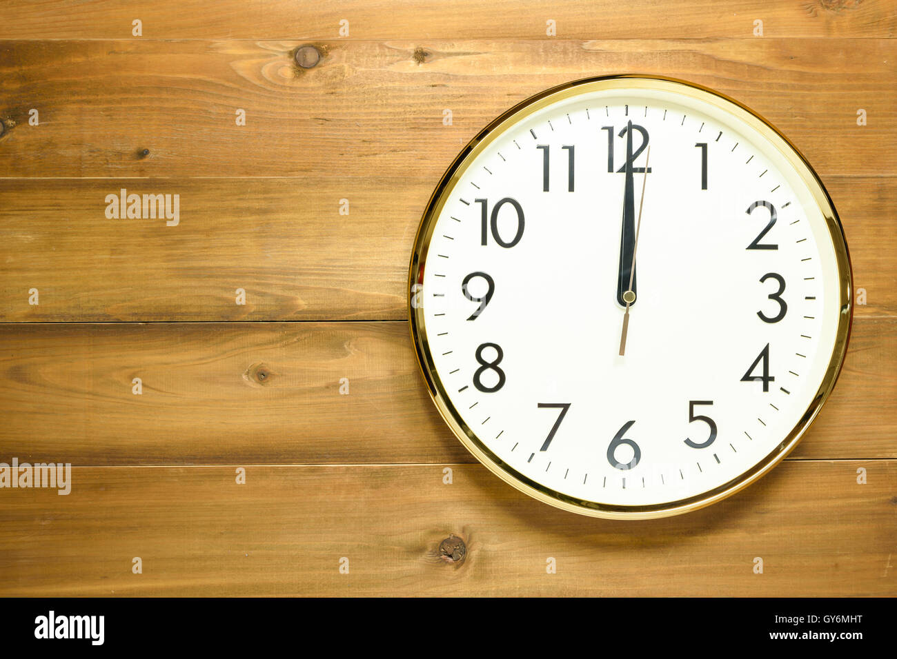 wall clock on the wooden wall at time 12am or 12pm Stock ...