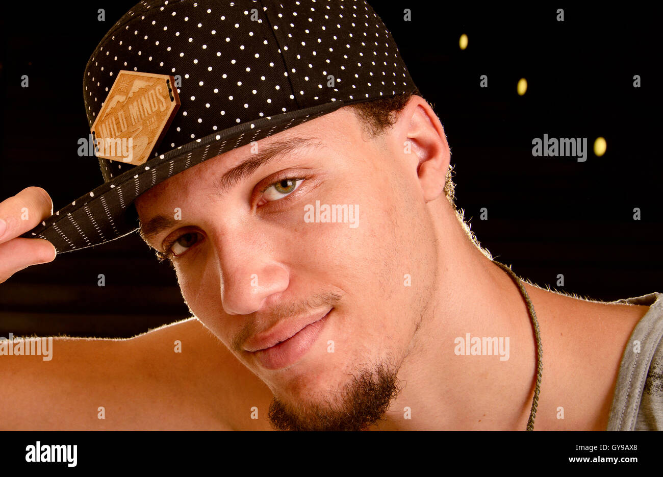 A 21-year-old man wearing a cap poses for a portrait, Tucson, Arizona, USA. - Stock Image