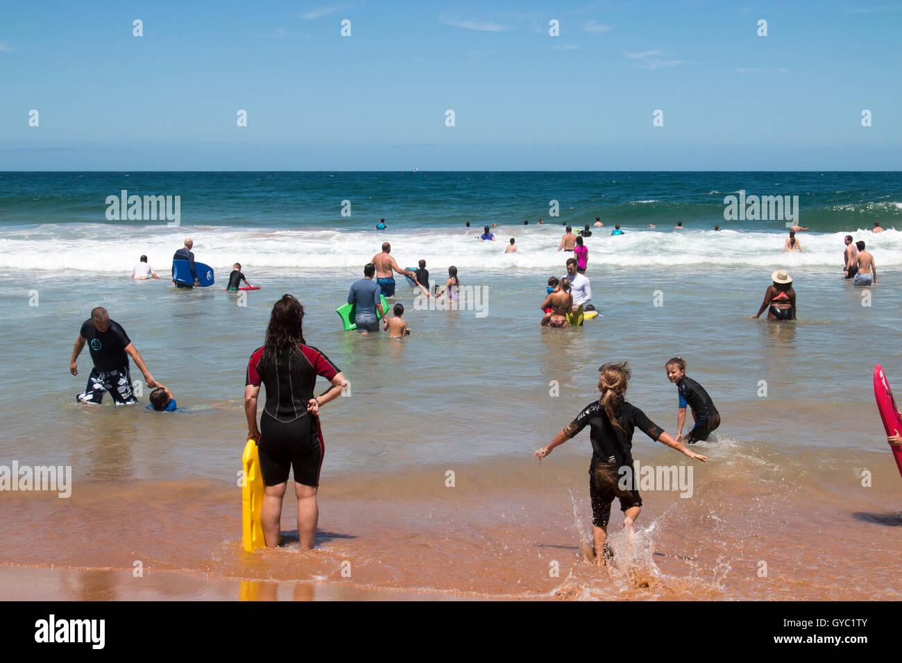 Families and children enjoying the ocean at Bilgola Beach,Sydney during summer, Australia Stock Photo