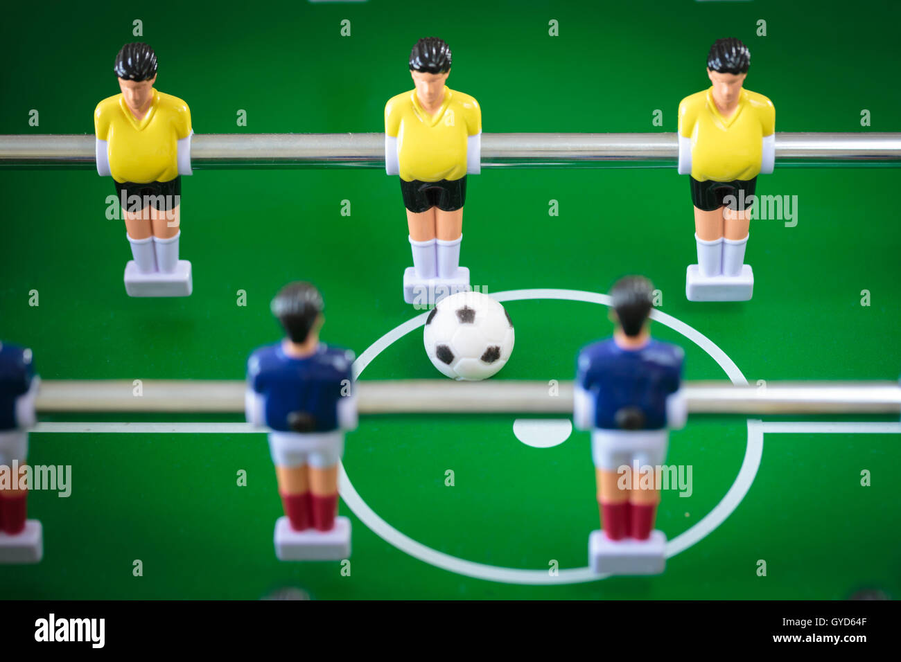 Football players miniatures from the kicker table game - Stock Image
