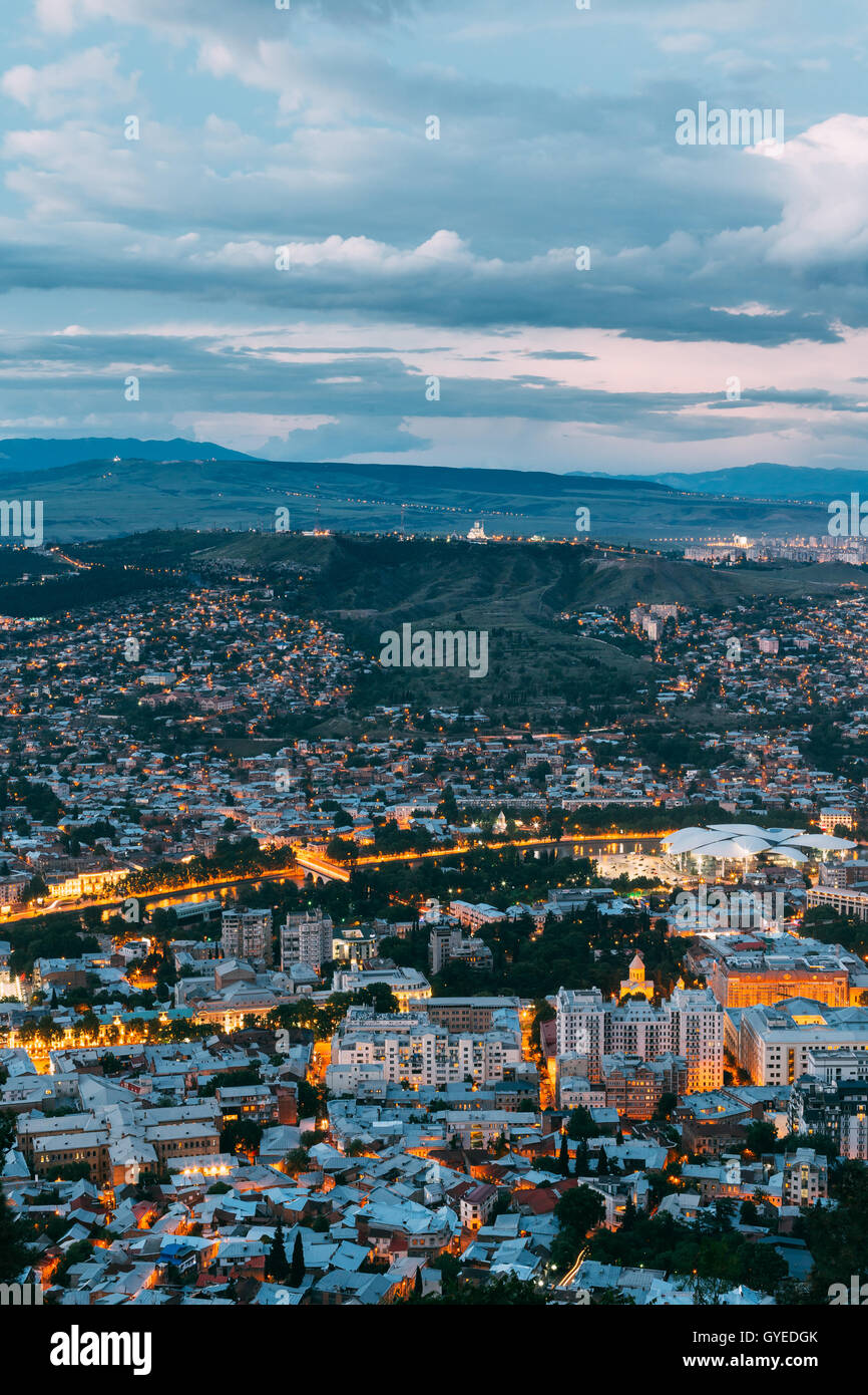 Tbilisi, Georgia. The Aerial Cityscape View Of Capital In Evening Illimination, The Modern City District Of High - Stock Image
