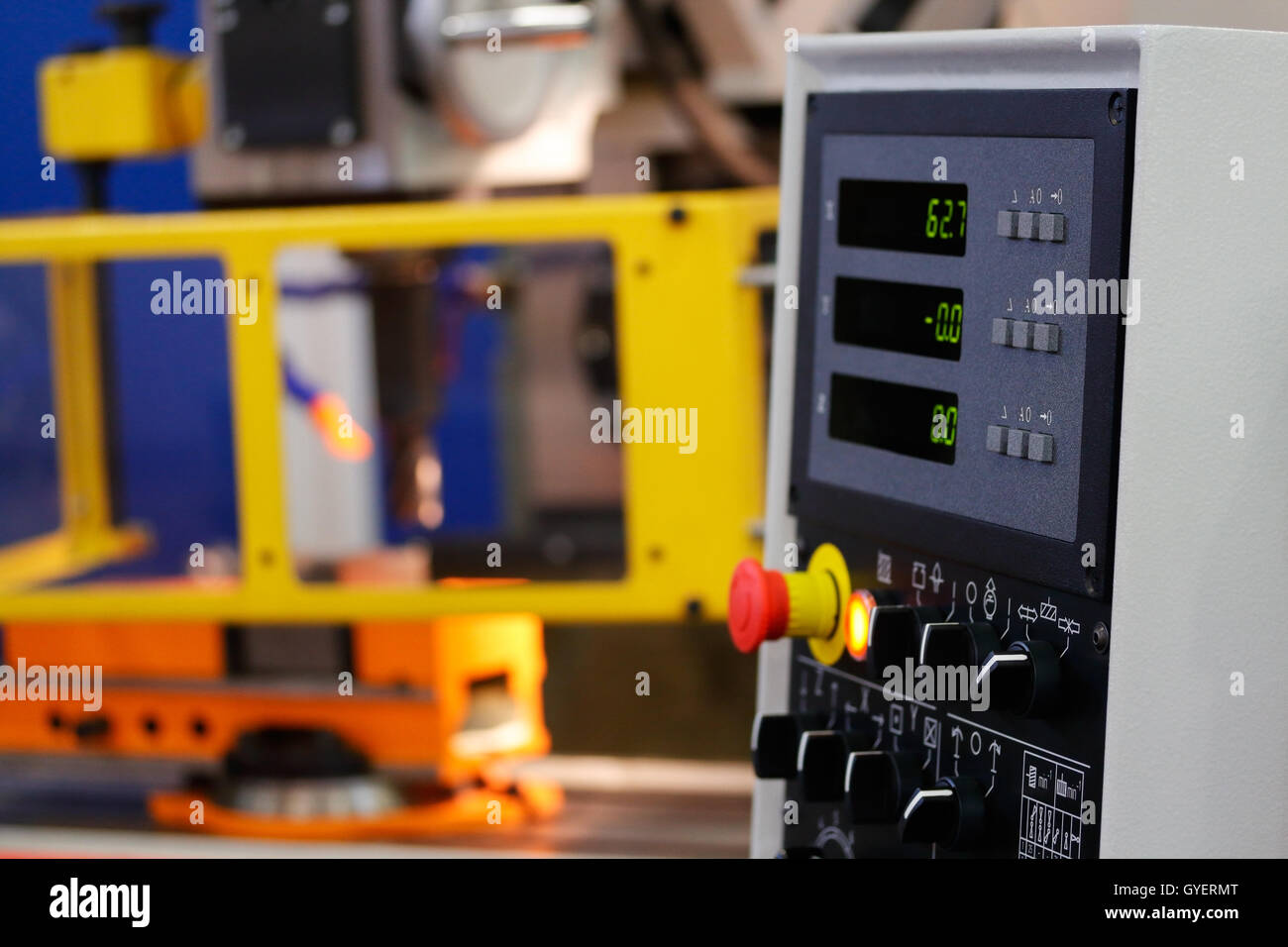 Vertical CNC machining center with control panel on the foreground. - Stock Image