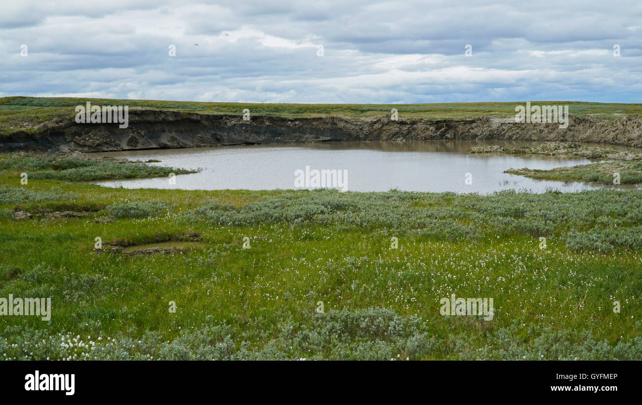 YAMAL PENINSULA, RUSSIA - JUNE 18, 2015: Helicopter expedition to the giant funnel of unknown origin. - Stock Image