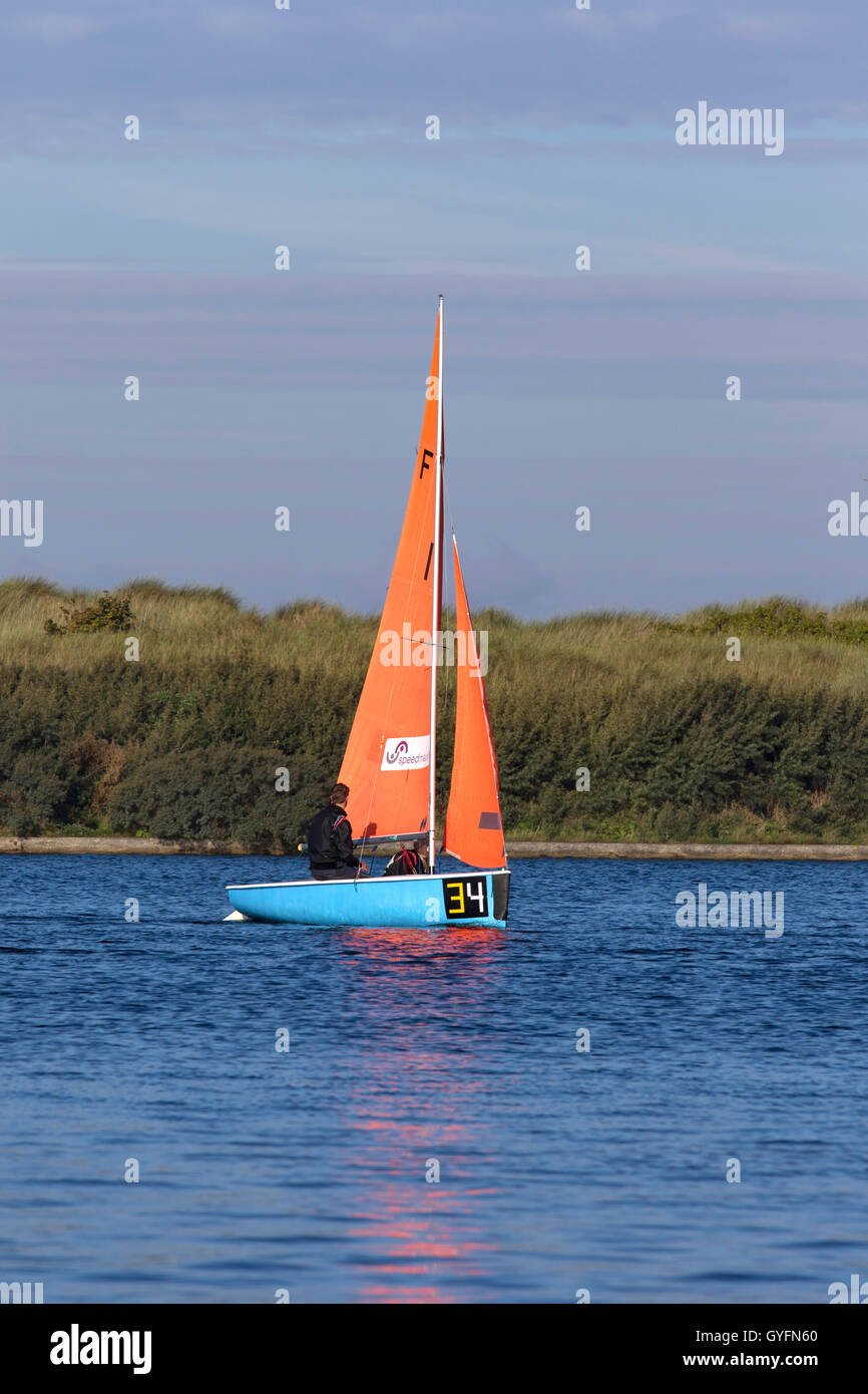 Yacht With Orange Sails Stock Photos & Yacht With Orange Sails Stock