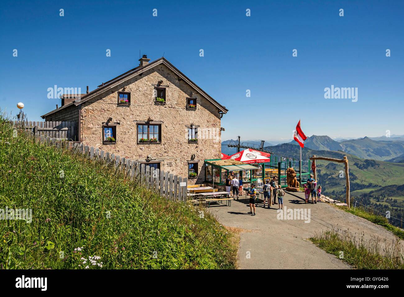 Cottage at high altitude at Kitzbuhel peak, popular ski resort and summer destination for hiking in Tirol - Stock Image