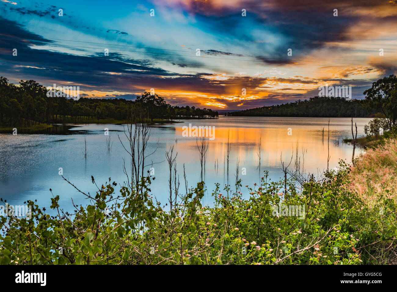 Wivenhoe Dam across Brisbane River at sunset - Stock Image