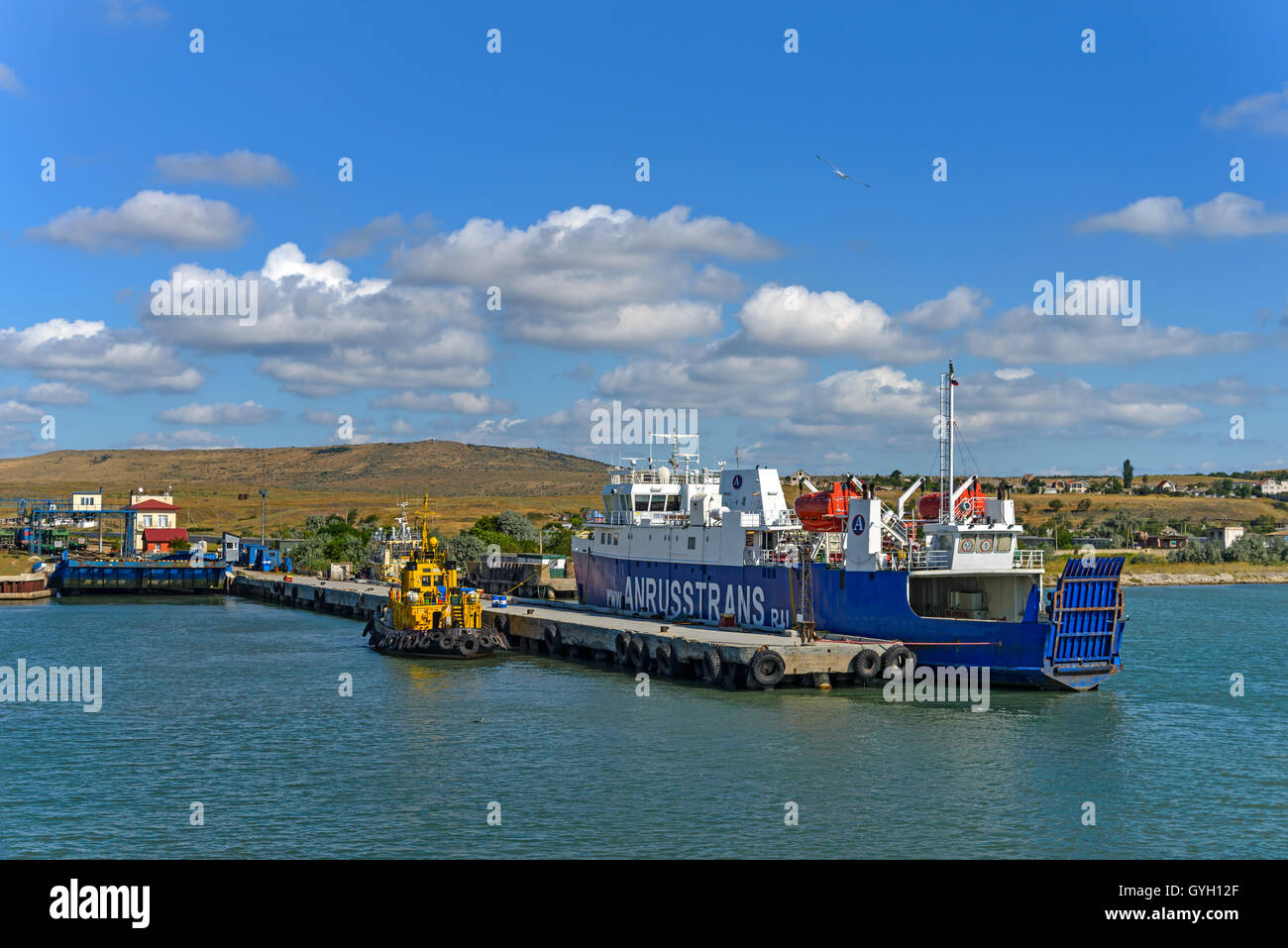 The port of Crimea with standing there by ferry and tugboat - Stock Image