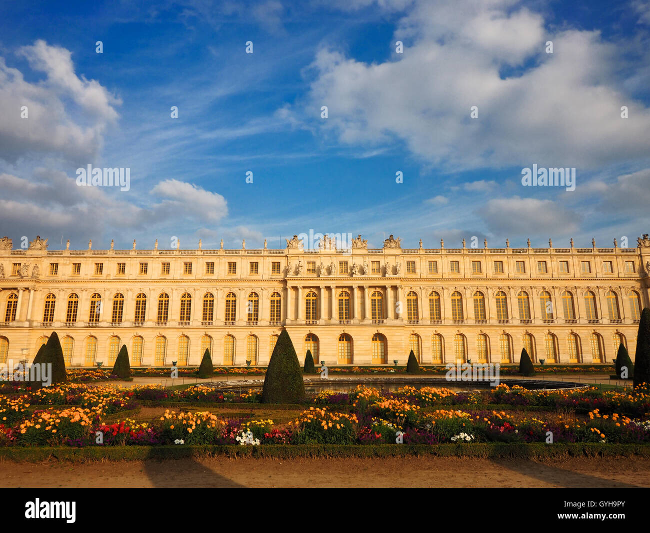 Facade of Palace of Versailles from Parterre du Midi in the evening, France - Stock Image